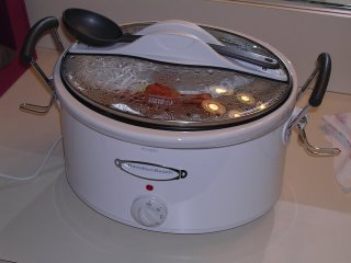 My new crockpot with the lock-down lid, usable carrying handles and it's own spoon