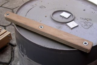 wooden brace with nuts recessed into the side