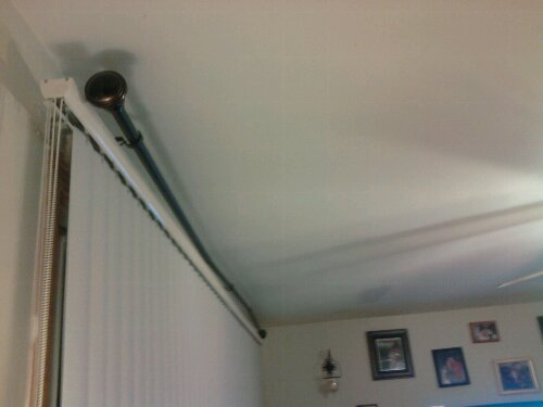 All that work to make 3 brackets, and it looks like hell. The curtain rod is too short.